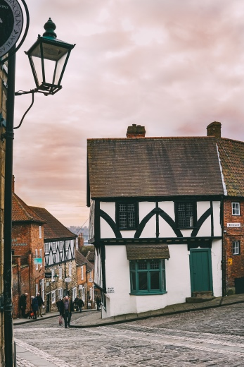 Steep Hill, a cobbled street, lined with independent shops, tea rooms and restaurants that leads to and from Lincoln Cathedral.